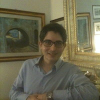 Law academic Daniele D'Alvia props his elbow on a mantlepiece