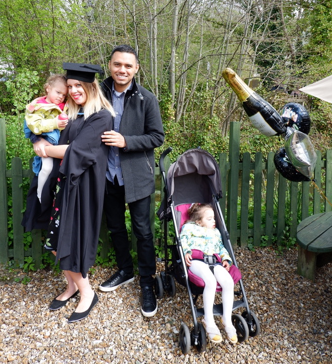 Ella Michalski with her family on her graduation day