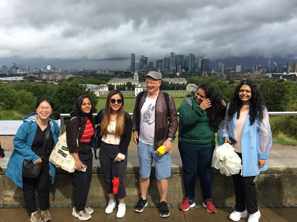 International students standing by the Greenwich observatoy