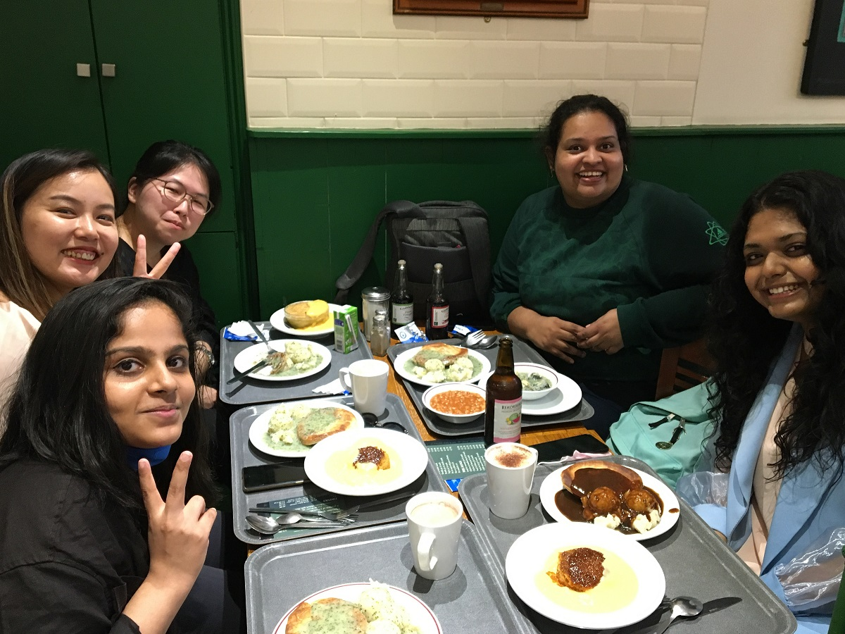 International students at a pie and mash shop
