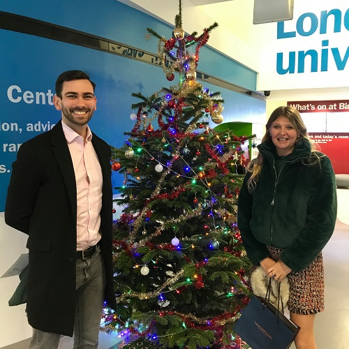 Birkbeck BEI staff by the Christmas Tree