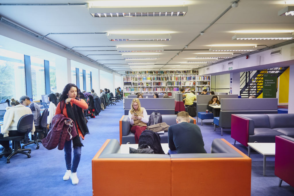 Photo of the first floor entrance to the Library showing a comfortable, informal group study area.