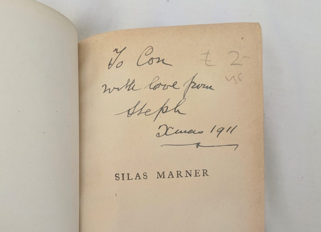Photo of the dedication inside the copy of Silas Marner. It says: 'To Con, with love from Steph. Xmas 1911.'