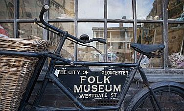 Gloucester Folk Museum sign on an old bicycle