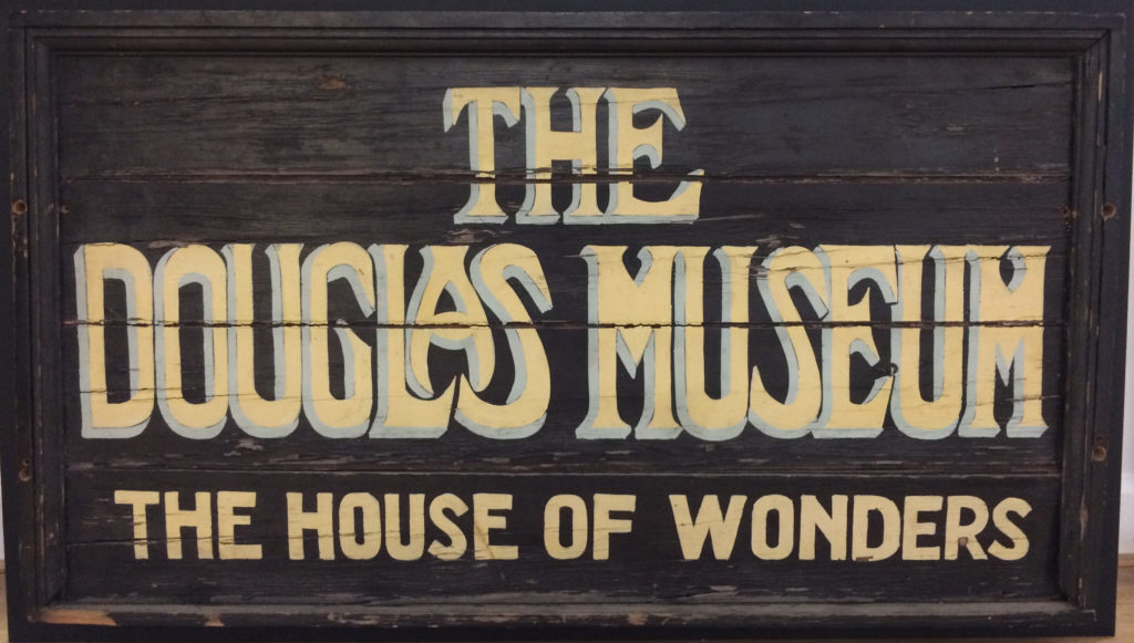 Sign for The Douglas Museum - The House of Wonders