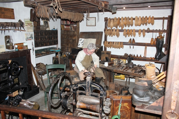 Interior of Nidderdale Museum. Cobbler's workshop, sewing machine, mangle, and other tools