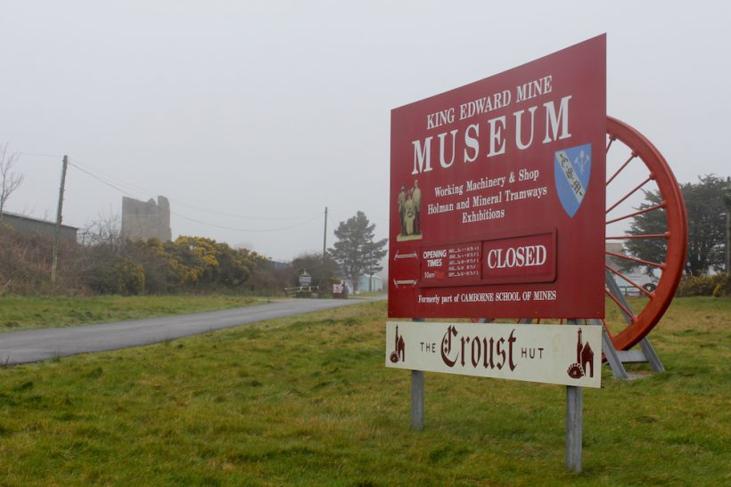 Entrance to King Edward Mine Museum, Cornwall, with large sign on the right