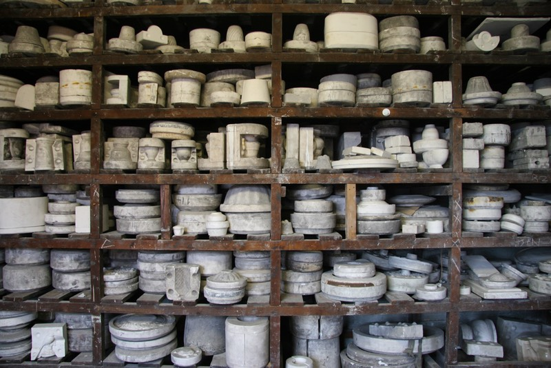 Gladstone pottery, an abundance of ceramic moulds on wooden shelves