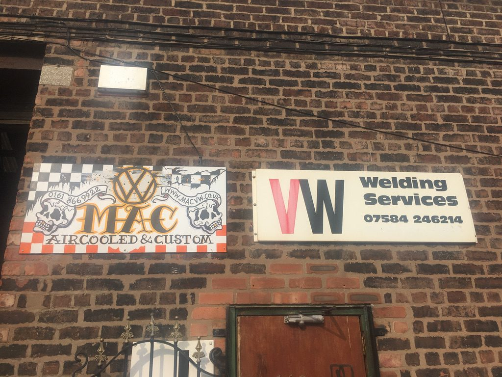 Macs VW in Manchester - view of signs on a brick wall