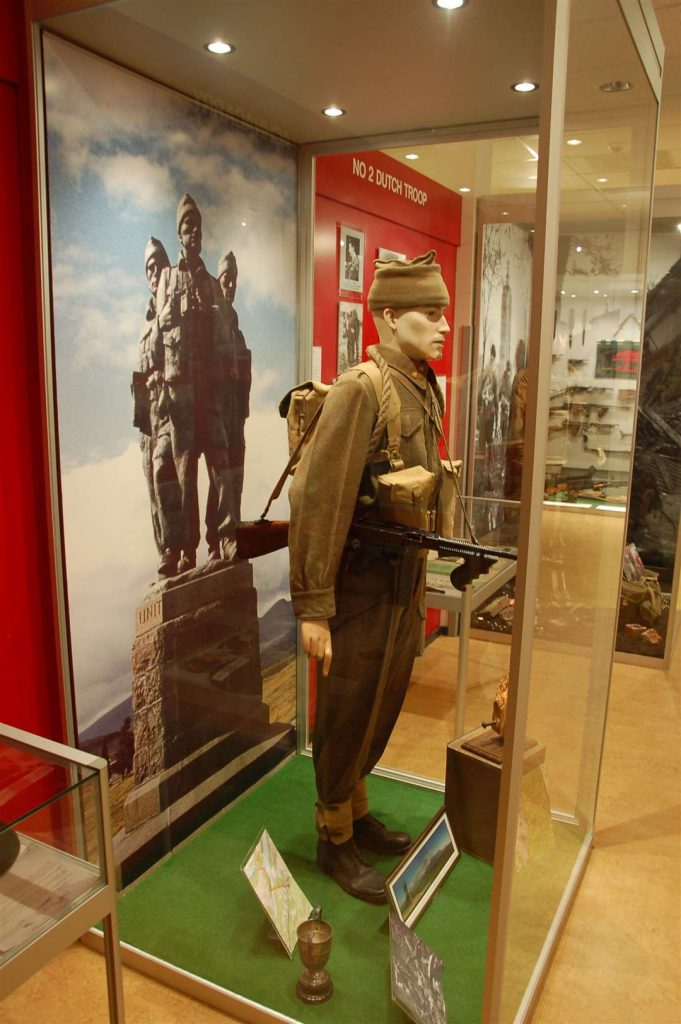 Inside the Commando Museum. In the foreground is a mannequin dressed in commando uniform in a glass case.