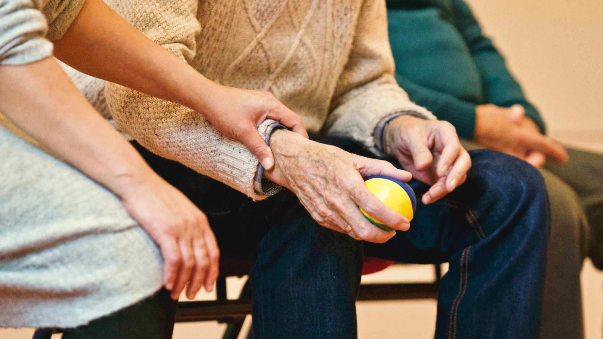 A carer with and elderly person in a carehome