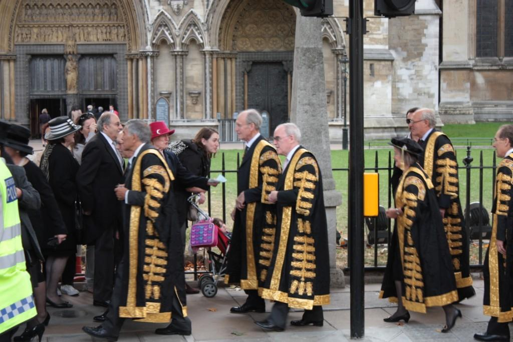1st October 2009, the opening day of the new Supreme Court of the United Kingdom.  Judges of the Supreme Court dressed in their gilded ceremonial robes of office negotiate their way through a group of pedestrians as they process from the Court to Westminster Abbey to attend the Judges Service to celebrate the opening of the new legal year. © Leslie J Moran 2014.