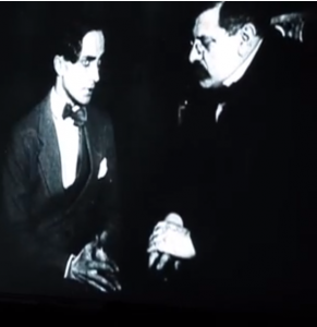 Conrad Veidt and Magnus Hirschfeld in Anders als die Andern (dir. Richard Oswald, 1919), a film about homosexual blackmail featuring Hirschfeld. It ends with the tragic suicide of the blackmail victim. Screenshot.