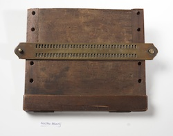 Braille writing frame as used by Dr T. R. Armitage, c. 1880. Wood and brass.