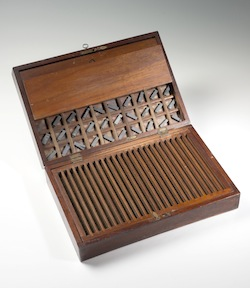 Klein Type Box, c. 1840 (folding box, green felt backing to type board, 24 lines, lead type. With key and catches).