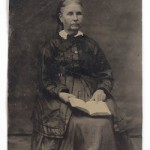 Unknown photographer. Unknown Woman Reading an Embossed Book, tintype photograph (c. 1860s).